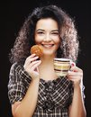 Woman with coffee and cookies young Royalty Free Stock Photography