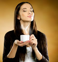 Woman with coffee cup Stock Photography