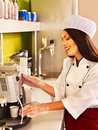Woman with coffee machine waitresses at cafeteria Royalty Free Stock Photos
