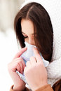 Woman with a cold holding a tissue Stock Photography