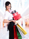 Woman with color shopping bags and boxes. Stock Photos