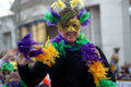 Woman in colorful costume a marches mardi gras parade Stock Photography