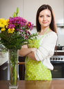 Woman with colorful flowers in vase Royalty Free Stock Photo