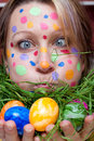 Woman with colorful points in the face Stock Image