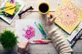 Woman coloring an adult coloring book, new stress relieving trend, mindfulness concept