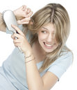 Woman combing her hair Royalty Free Stock Images
