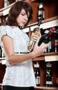 Woman comparing two wines Royalty Free Stock Images