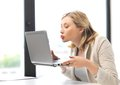 Woman with computer kissing the screen picture of laptop Royalty Free Stock Photo