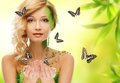 Woman in conceptual spring costume beautiful young with butterflies around her Stock Photos