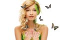 Woman in conceptual spring costume beautiful young with butterflies around her Stock Photography