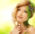 Woman in conceptual spring costume beautiful young with butterfly her hair Royalty Free Stock Images