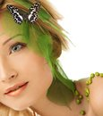 Woman in conceptual spring costume beautiful young with butterfly her hair Stock Photos