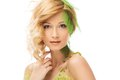 Woman in conceptual spring costume beautiful young touching her face Stock Photography
