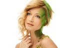 Woman in conceptual spring costume beautiful young touching her face Royalty Free Stock Photos