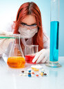 Woman conducting chemical experiment close up chemist Stock Photos