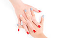 Woman connected hands with red and blue shellac nail polish Royalty Free Stock Photo
