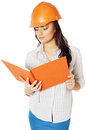 Woman in construction helmet the the with a notebook hand Royalty Free Stock Image