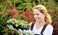 Woman with container-grown plants Stock Photos