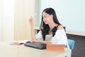 Woman contemplating what to write in office Royalty Free Stock Photo