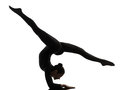 Woman contortionist  exercising gymnastic yoga   silhouette Royalty Free Stock Photo