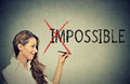 Woman converting the word impossible to possible young happy positive thinking and success concept Royalty Free Stock Photography