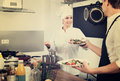 Woman cook giving to waitress ready to serve salad Royalty Free Stock Photo