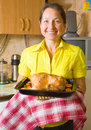 Woman with cooked  chicken Stock Photo