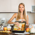 Woman cooking apple pie young smiling preparing cake in domestic kitchen Stock Images