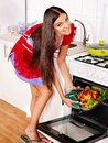 Woman cooking chicken at kitchen young Royalty Free Stock Photography