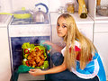 Woman cooking chicken at kitchen young Royalty Free Stock Image