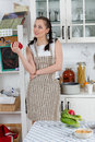 Woman cooking food in the kitchen beautiful an apron healthy Royalty Free Stock Images