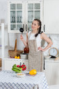 Woman cooking food in the kitchen beautiful an apron healthy Stock Photography