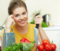 Woman cooking healthy food in the kitchen Royalty Free Stock Images