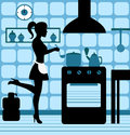 Woman cooking in the kitchen female silhouette standing at stove Royalty Free Stock Photography