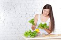 Woman cooking salad Royalty Free Stock Photography