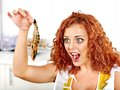Woman cooking shrimp happy Stock Photography