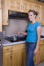 Woman cooking on stove Royalty Free Stock Photography