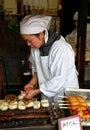 Woman cooking sweet Mitarashi Dango Royalty Free Stock Photo