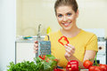 Woman cooking vegetables happy green salad in the kitchen Stock Image