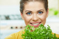 Woman cooking vegetables happy green salad in the kitchen Royalty Free Stock Images