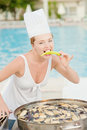 Woman cooks food Royalty Free Stock Photo