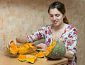 Woman cooks pumpkin Royalty Free Stock Photography