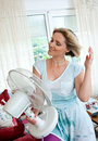 Woman cooling herself Royalty Free Stock Photo