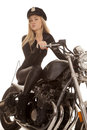 Woman cop motorcycle ride look a is riding her Stock Image