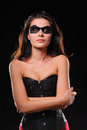 Woman in corset and black mask Stock Images