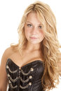 Woman corset blond woman a with a serious expression on her face wearing a black Royalty Free Stock Image
