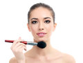 Woman with a cosmetic brush white background copyspace Royalty Free Stock Image
