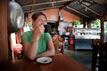 Woman in a Costa Rican cafe Stock Photo