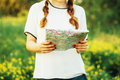Woman at countryside young caucasian woman hiking with backpack looking at map closeup of woman s hands holding a map Royalty Free Stock Photography
