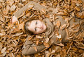 Woman covered with Autumn Leaves Royalty Free Stock Photography
